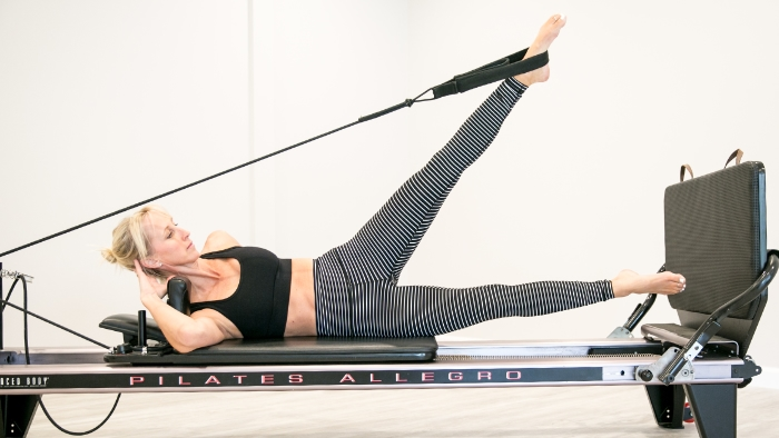 women teaching pilates in black and white outfit