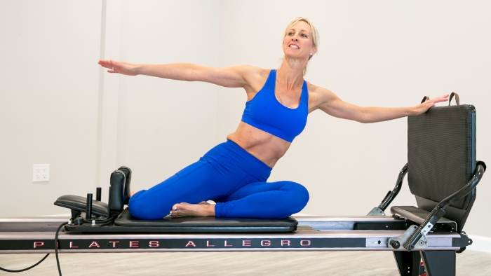 women teaching pilates in blue outfit