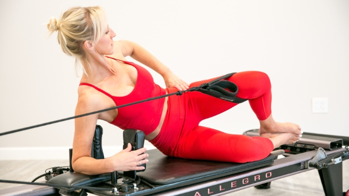 women teaching pilates in red outfit