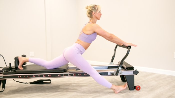 women teaching pilates in light purple outfit