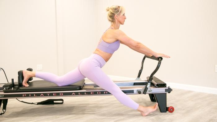 women teaching pilates in light purple outfit