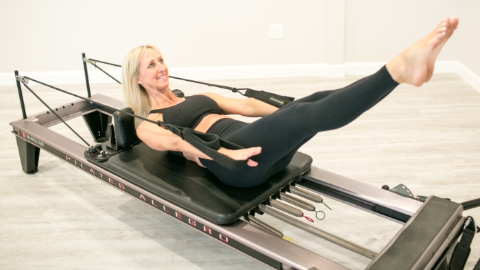 women teaching pilates in black outfit